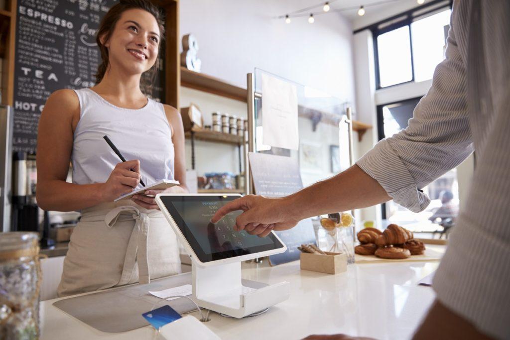 Coffee shop owner taking orders