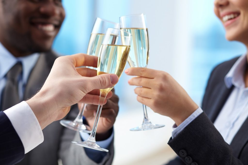 company employees drinking champagne