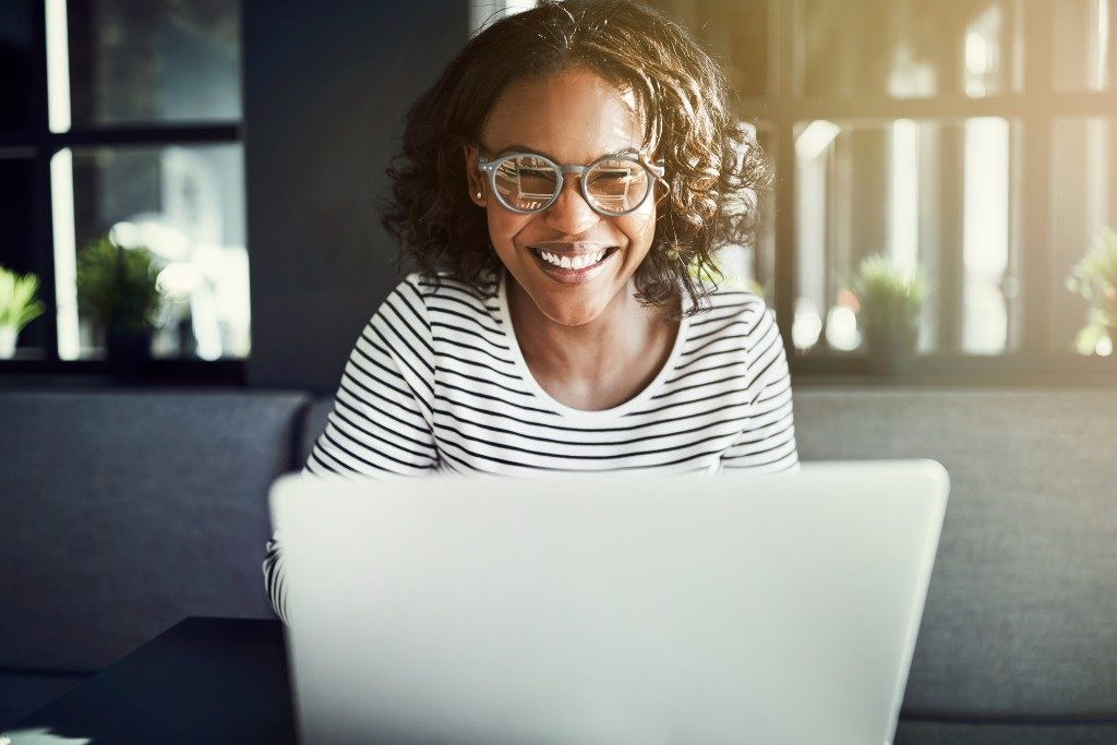 Woman in glasses working