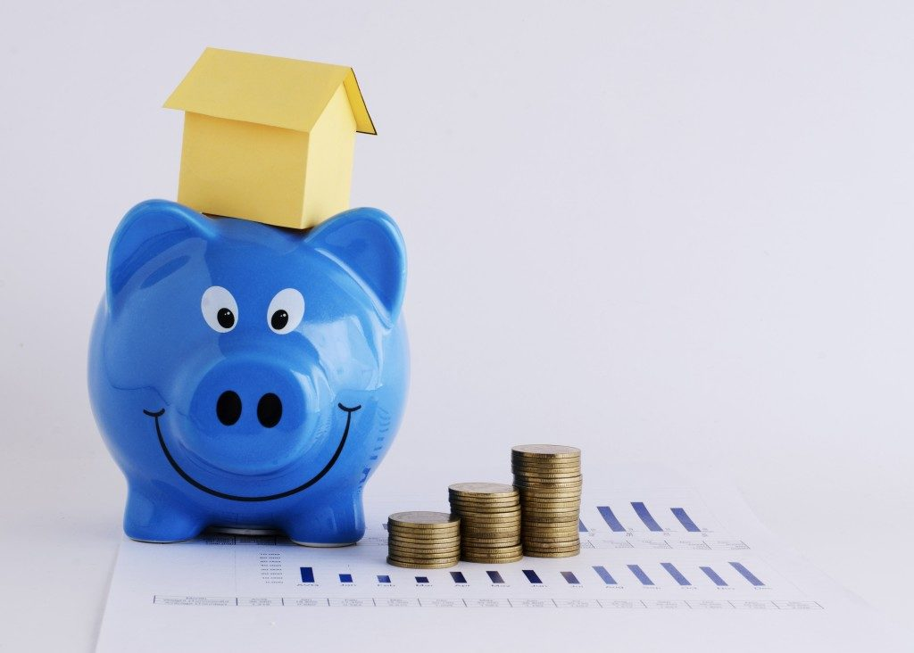 coins, piggy bank and house