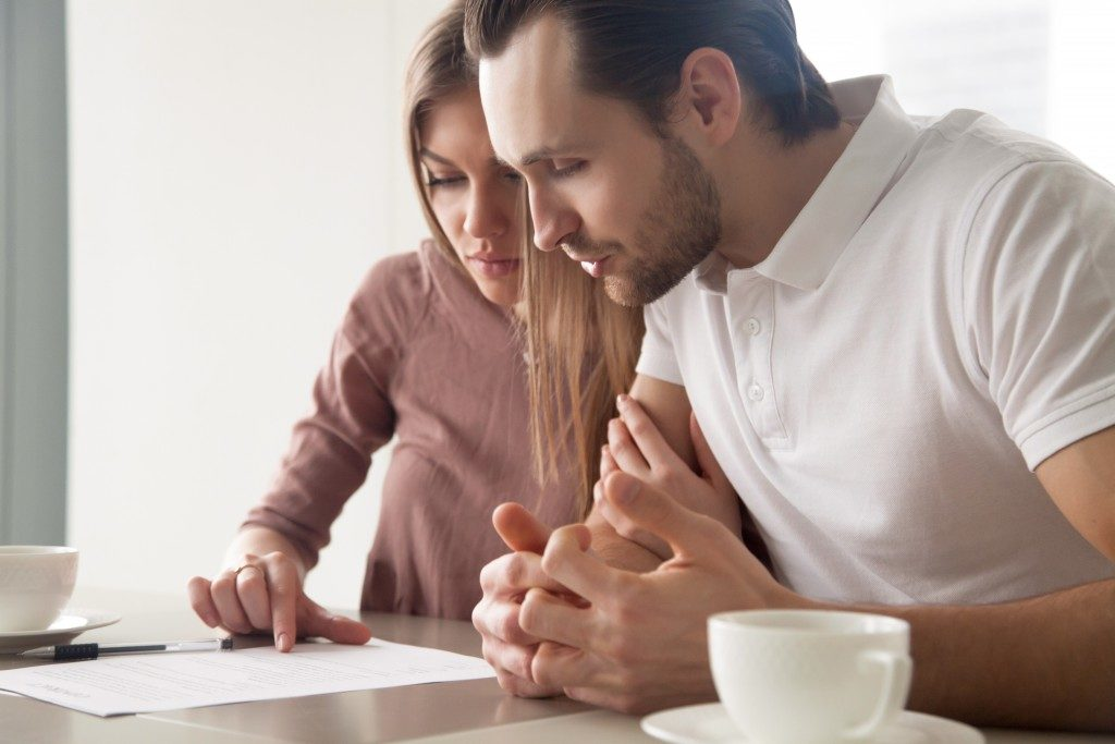 couple checking real estate document