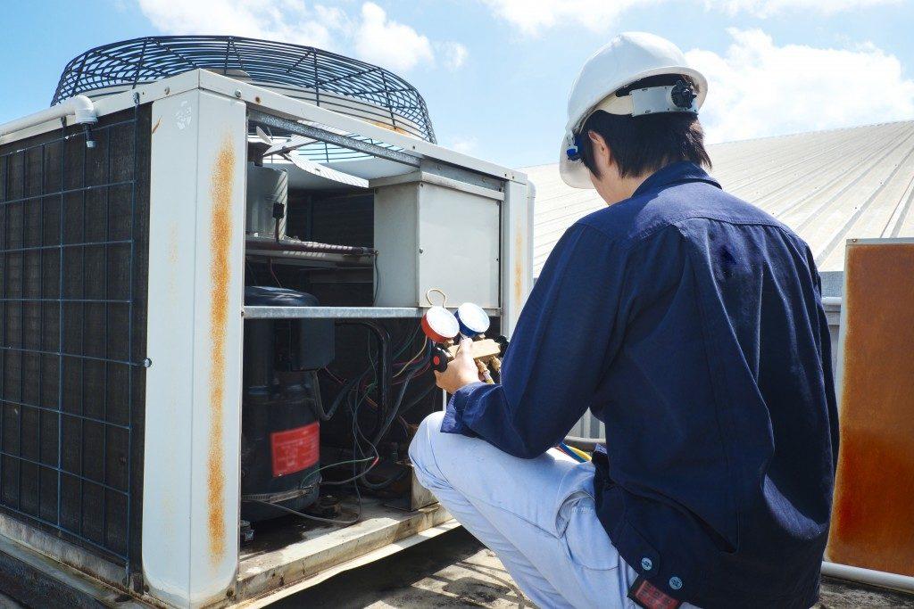 man doing maintenance work on an HVAC system