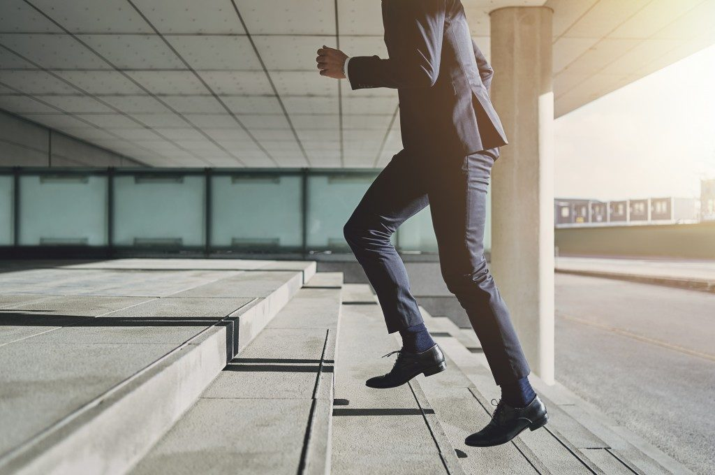 businessman going up the stairs
