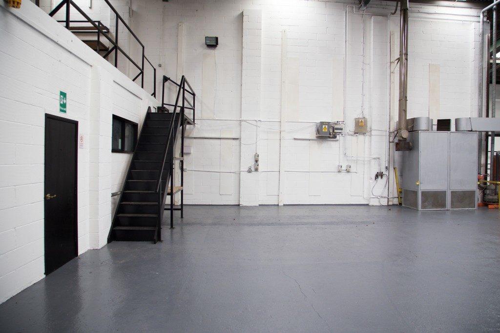 Stairs to mezzanine floor in vast empty warehouse