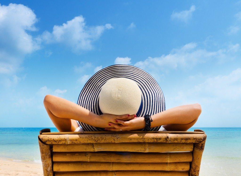 woman lying beside the beach