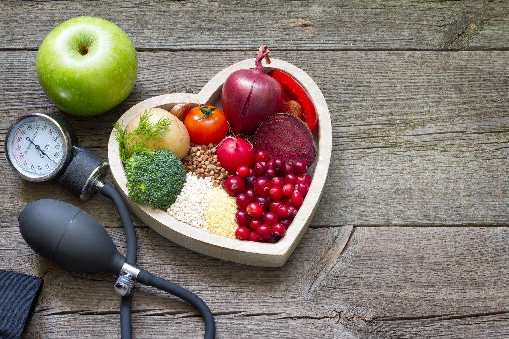 Diet food on heart bowl