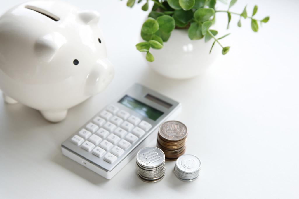 piggy bank, calculator, and coins