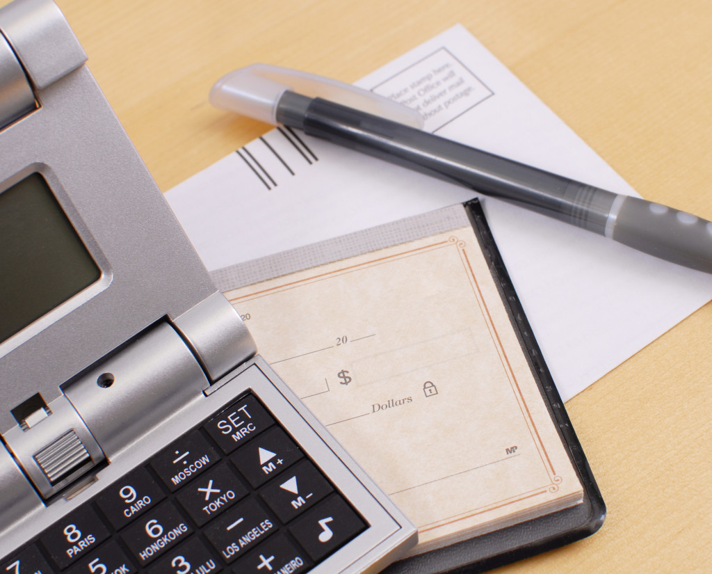 calculator pen and checkbook